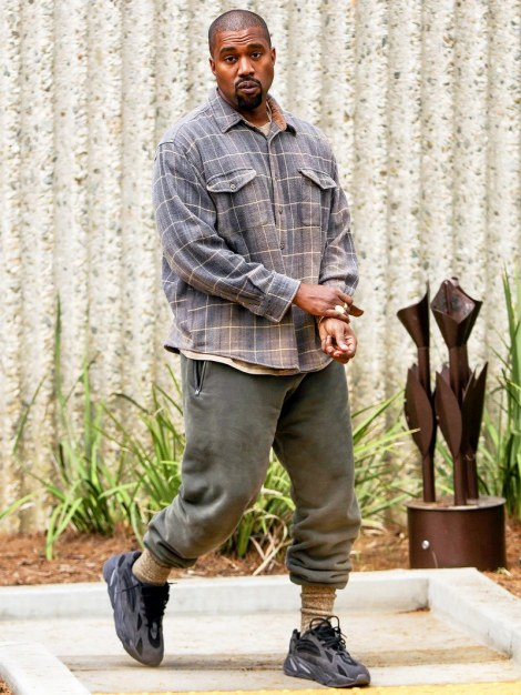 Kanye West wearing all-black Yeezy 700's.